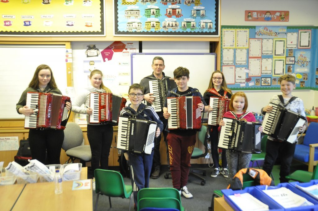 Michael Garvin taught a class of pupils to play accordion at this year's festival. 17_t15Feis03