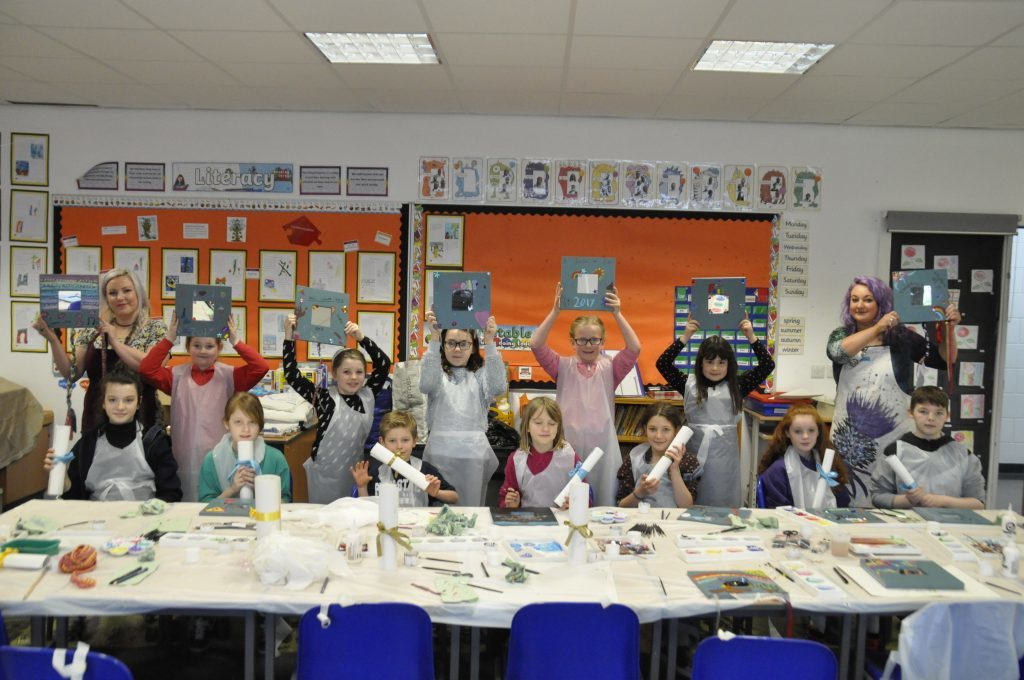 The arts and craft pupils show off their mirrors and diplomas in Laura and Nikki Currie's class. 17_t15Feis08.