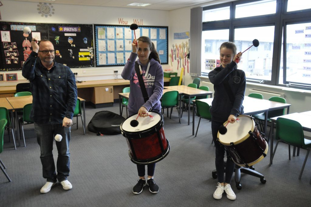 Stephen Kilbride, Sarah Cameron and Alice Jackson practice their timing in their pipe band drumming class. 17_t15Feis11