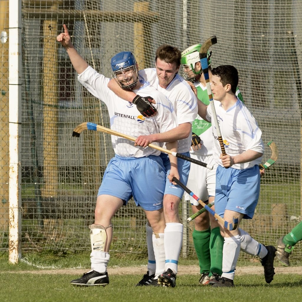 Skye's Will Cowie completes his hat-rick in the game against Beauly in the preliminary round of the the Tulloch Homes Camanachd Cup. Photograph: Neil Paterson.