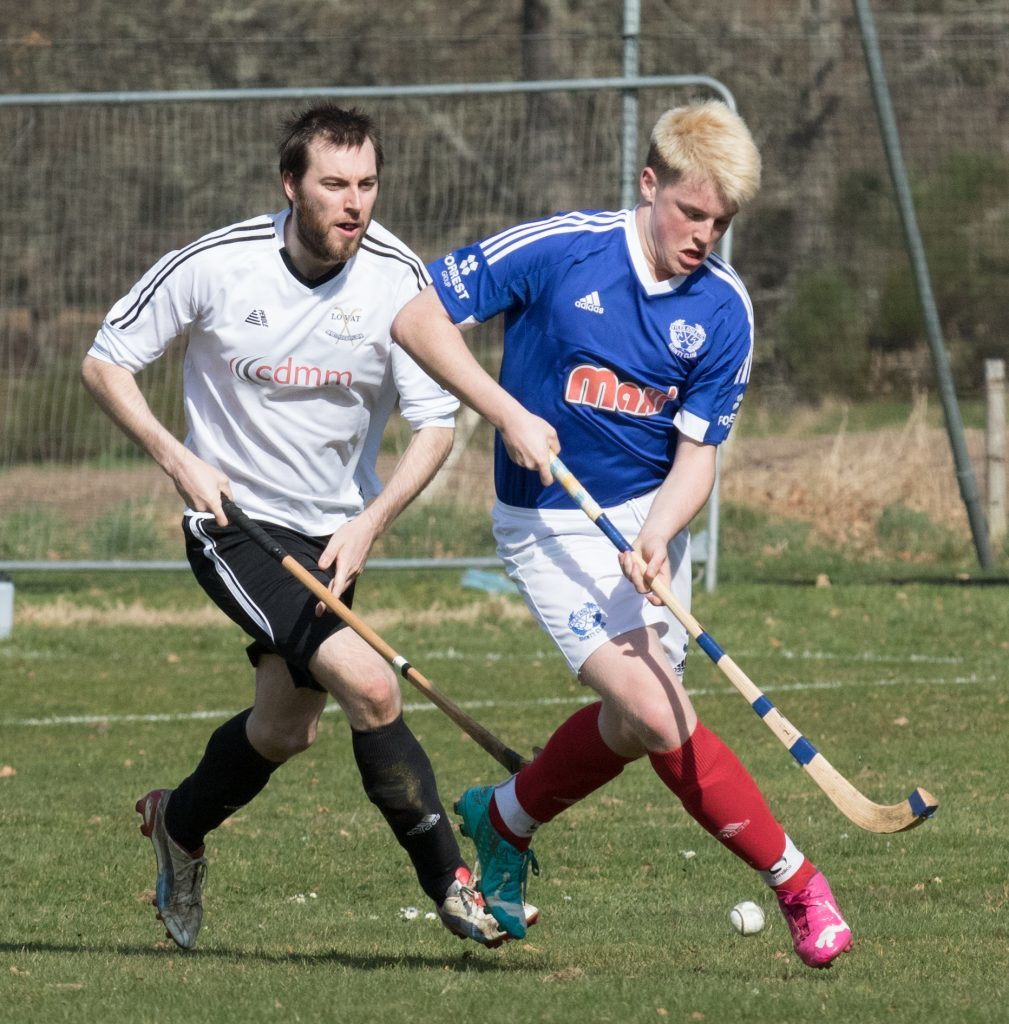Kyles Athletic's Cairn Limbert shields the ball from Lovat's Rory Campbell during last weekend's Sutherland Cup tie at Balgate. Photograph: Donald Cameron.