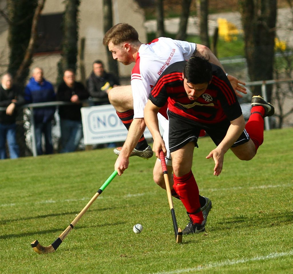 Oban Camanachd's Mattie Rippon takes a tumble in the 'D' in the game against Glenurquhart. Photograph: Kevin McGlynn.