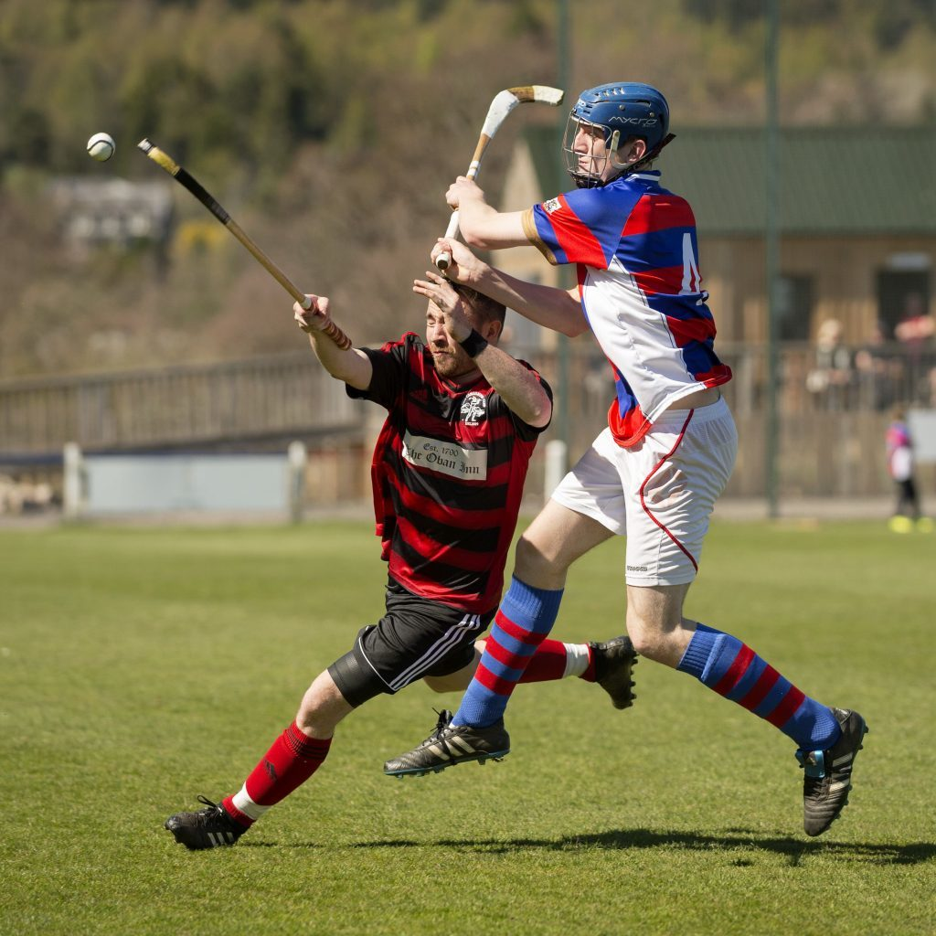 Alexander Michie, Kingussie, left, and Malcolm Clark, Oban Camanachd, in action in the Marine Harvest Premiership clash at the Dell on Saturday. Photograph: Neil Paterson.