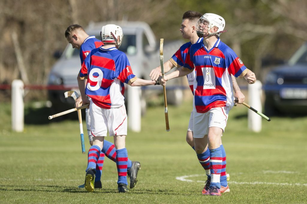 Roddy Young, right, celebrates his late winning goal for Kingussie against Oban Camanachd.   Photograph: Neil Paterson.