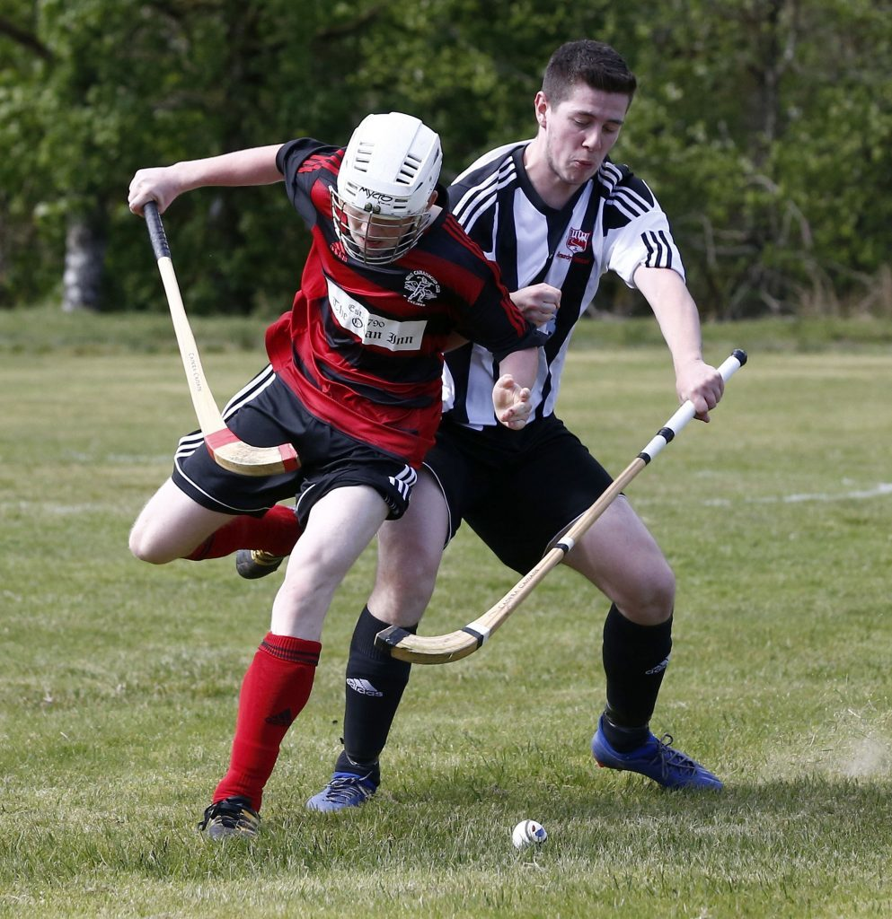 Craig MacMillan, Lochside Rovers, left, and Dylan Cook, Glenorchy, tussle for the ball during their game at The Mart park last Saturday. Photograph: Stephen Lawson.