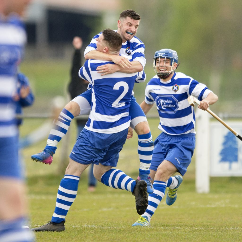 Celebrating the second goal for Newtonmore, Drew Macdonald jumps on his team captain Steven Macdonald. Photograph: Neil Paterson.