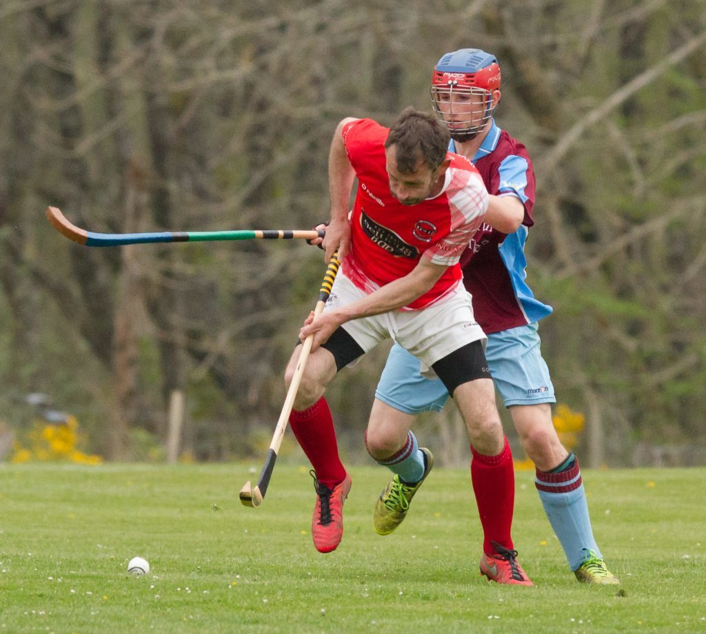Ewen MacKinnon, Inverness, gets to the ball before Niall McCallum of Strathglass during last weekend's Strathdearn Cup tie.  Photograph: Donald Cameron.