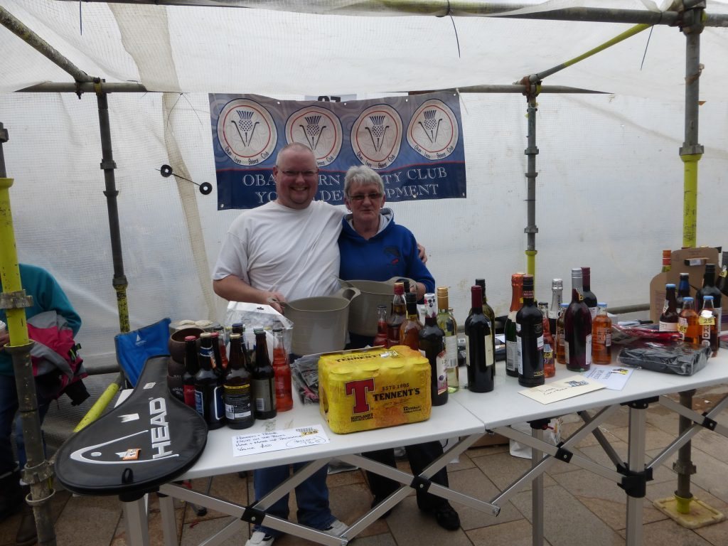Oban Lorn Shinty club Youth Development had a bottle stall to raise cash. Pictured are Malcolm Gillies and Margaret Beattie. Photograph: Alan Windram
