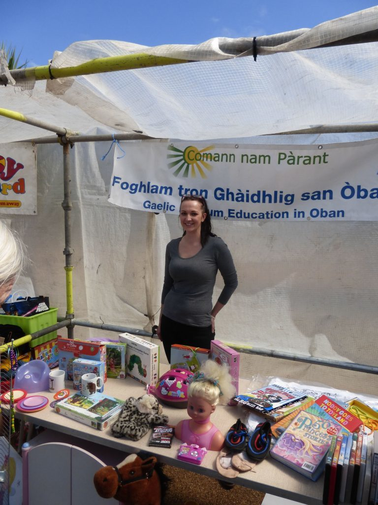 A stall for Gaelic-medium education unit in Oban, raising cash for extra activities.