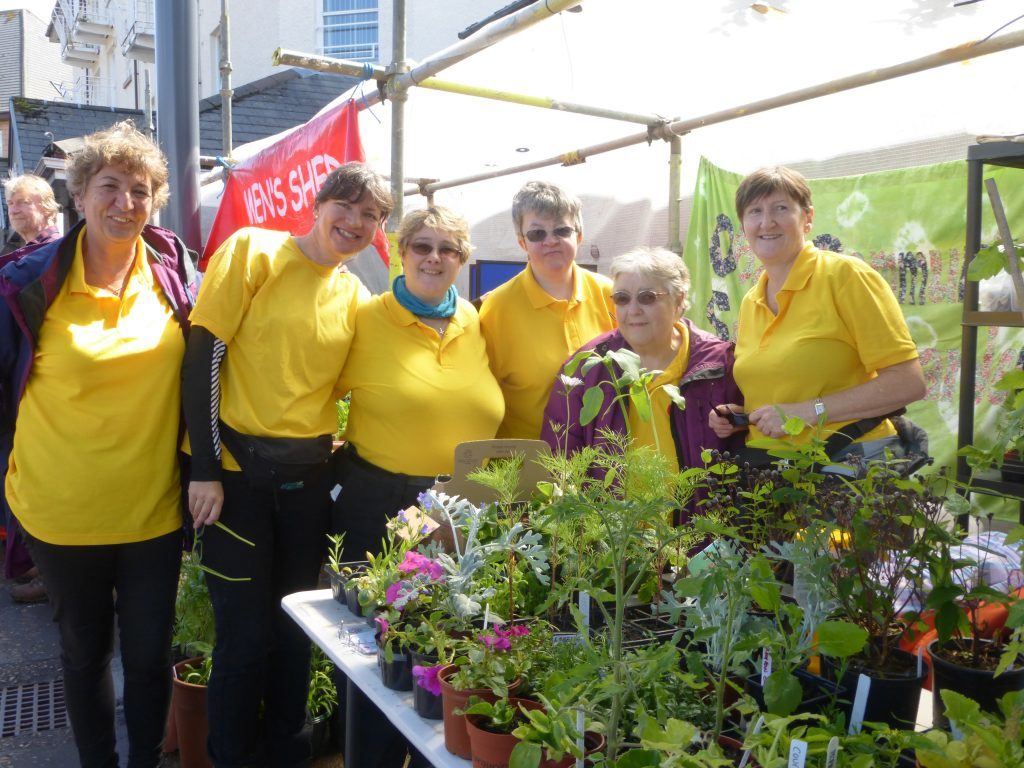 Oban Community Sensory Garden volunteers are, from left: Caroline Silkowski; Claire Rizos; Kerry McInnes; Marina MacDonald; Mari Scott and Linda Flannigan. The stall is busy every year with people buying plants and cards. Photograph: Alan Windram