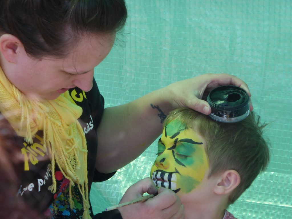 Kirsty MacKenzie was run off her feet with youngsters wanting their face painted. Photograph: Alan Windram