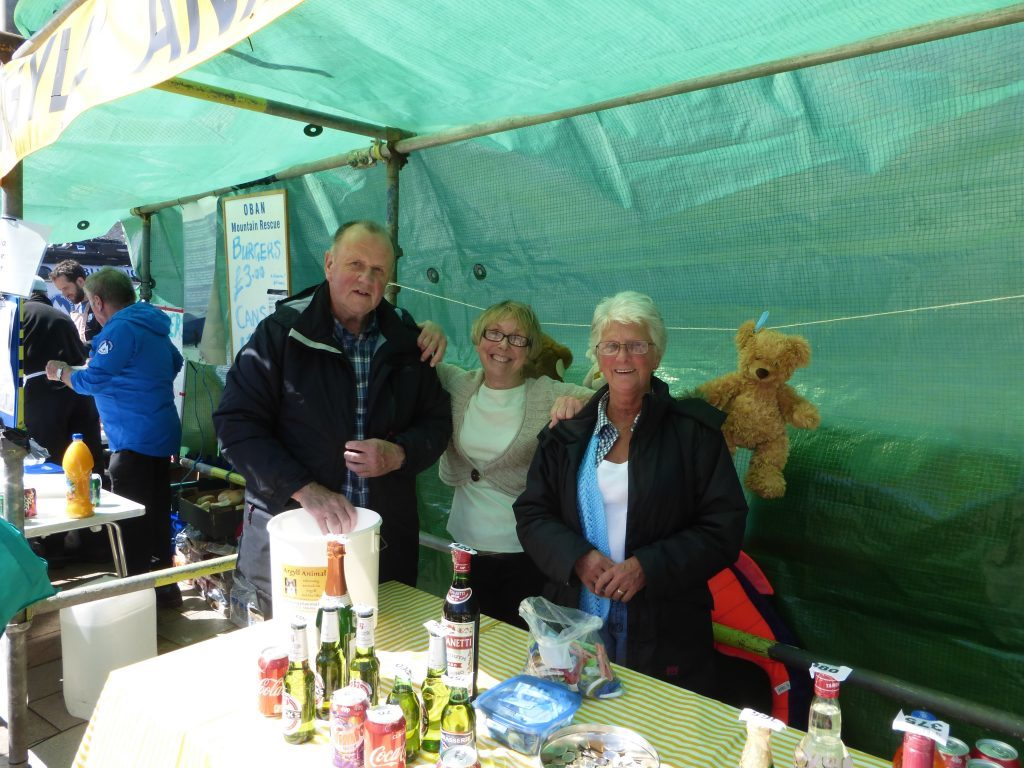 Argyll Animal Aid: John McPherson, Catherine Goodbrand, and Jean Sutherland. The work out of the Barcaldine centre where they mostly take in cats and dogs. The centre is always well supported by the local community. They won second prize for their stall. Photograph: Alan Windram