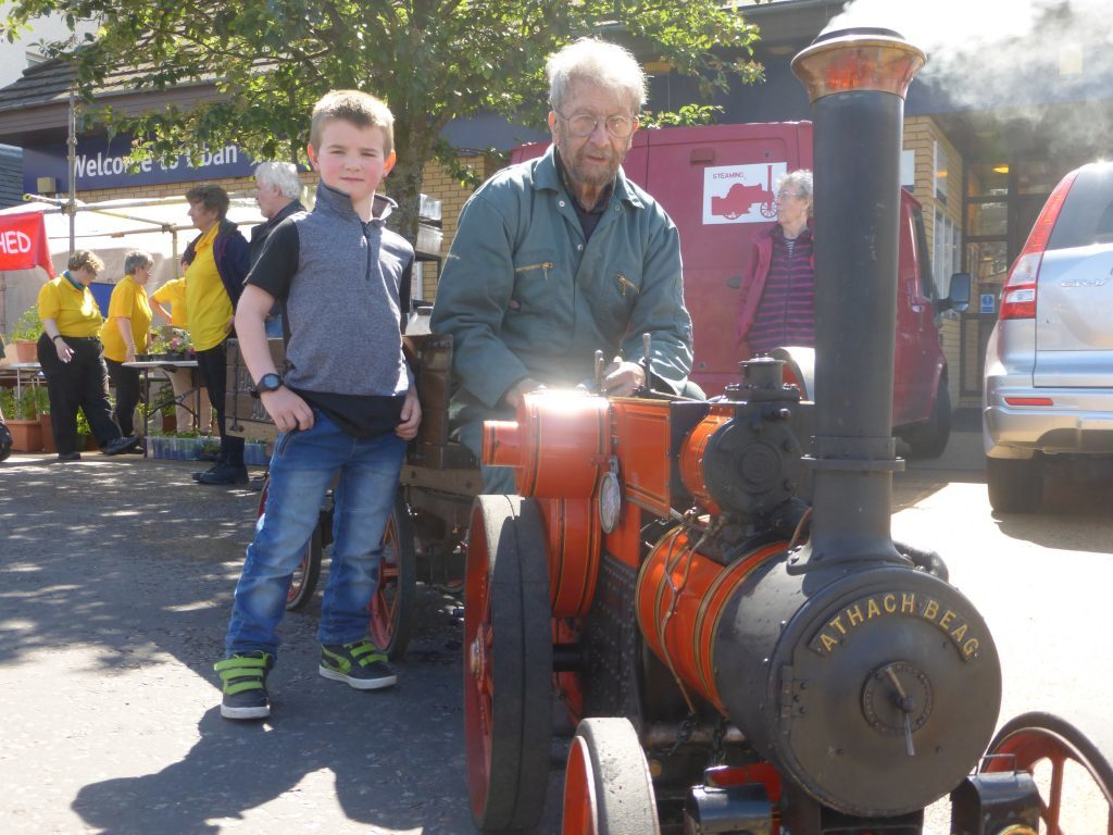 Dylan Ross was all smiles as he chatted to Harry Clyne. Harry had brought a scale model of a 1907 Tasker road tractor. Photograph: Alan Windram