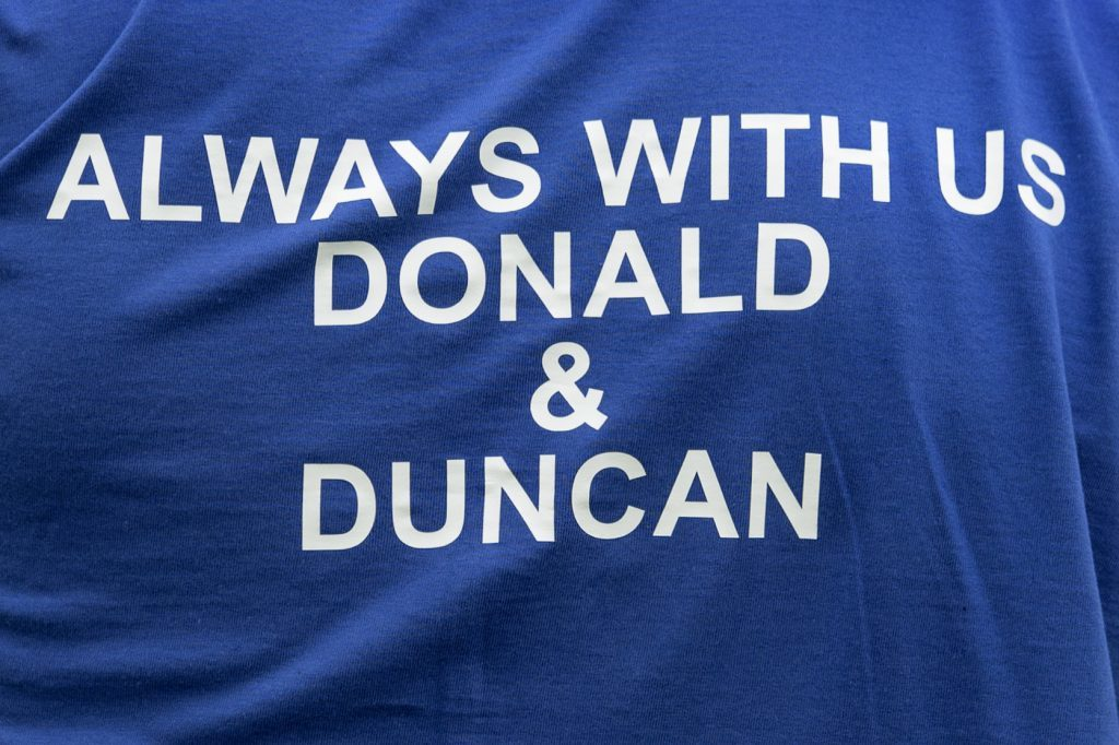 A touching message on the Kilmallie warm-up tops, in memory of Donald Lamont and Duncan Rodger who recently passed away.