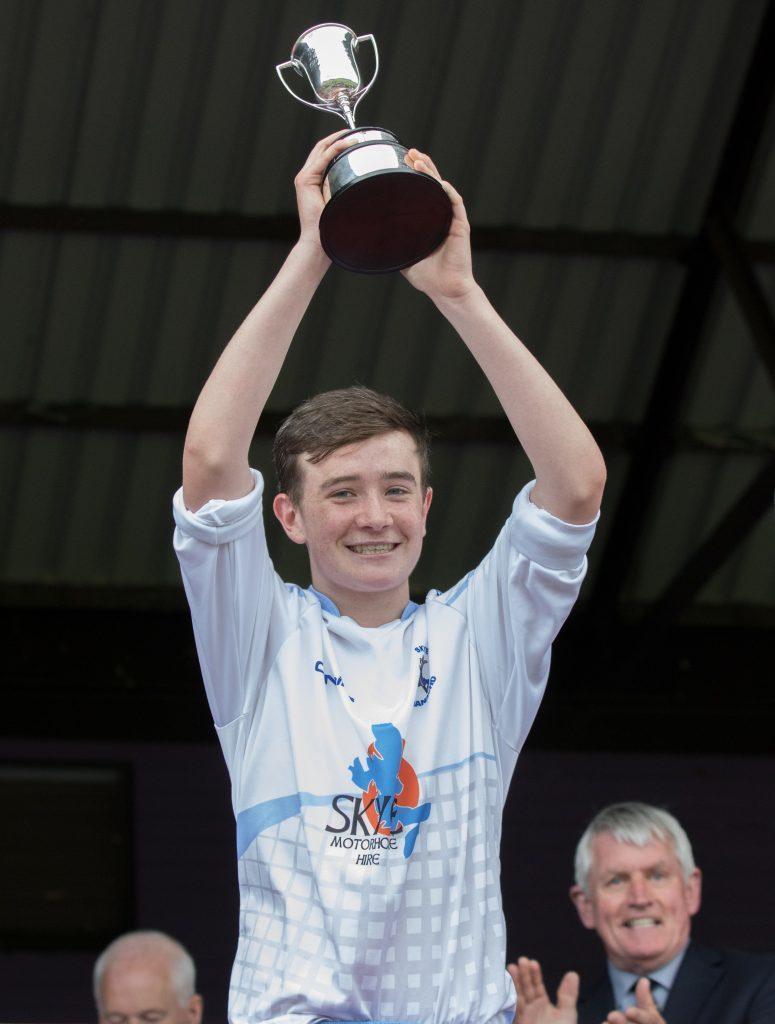 Skye's Stewart Taylor lifts the MacTavish Juvenile Cup. Photos: Donald Cameron.