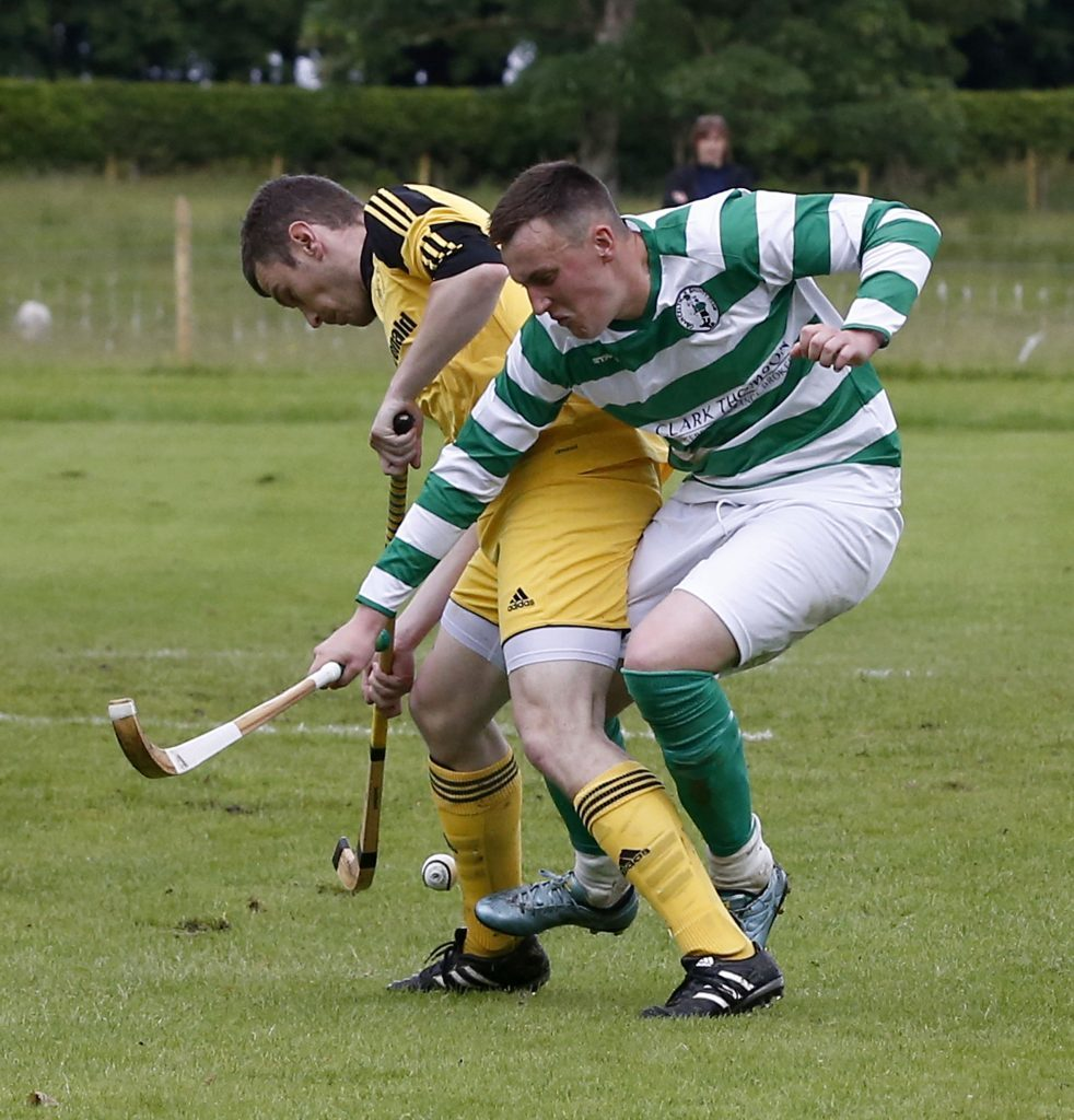 Inveraray's Allan MacDonald and Oban Celtic's Andy MacDonald in a tussle for the ball during their Balliemore Cup tie at the Winterton. Photograph: Stephen Lawson.