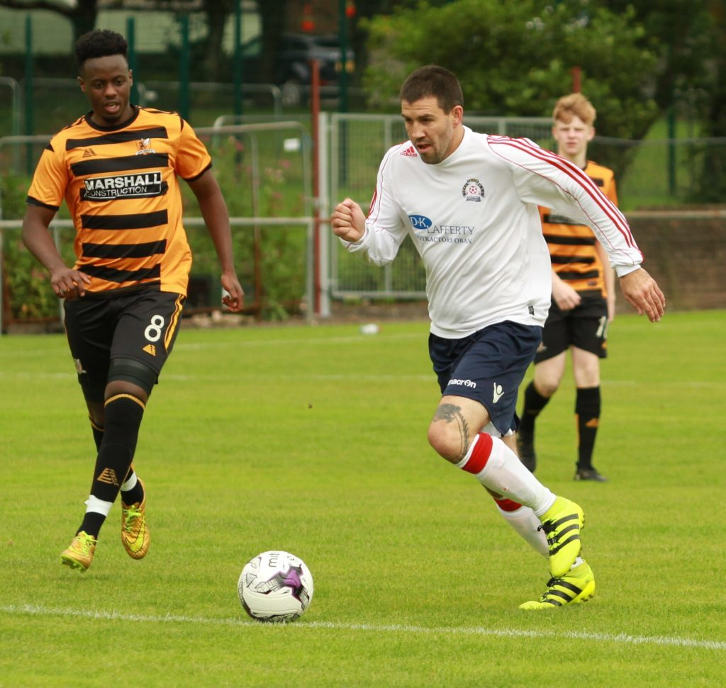 Donald Campbell heads for goal during the game against Alloa Athletic.