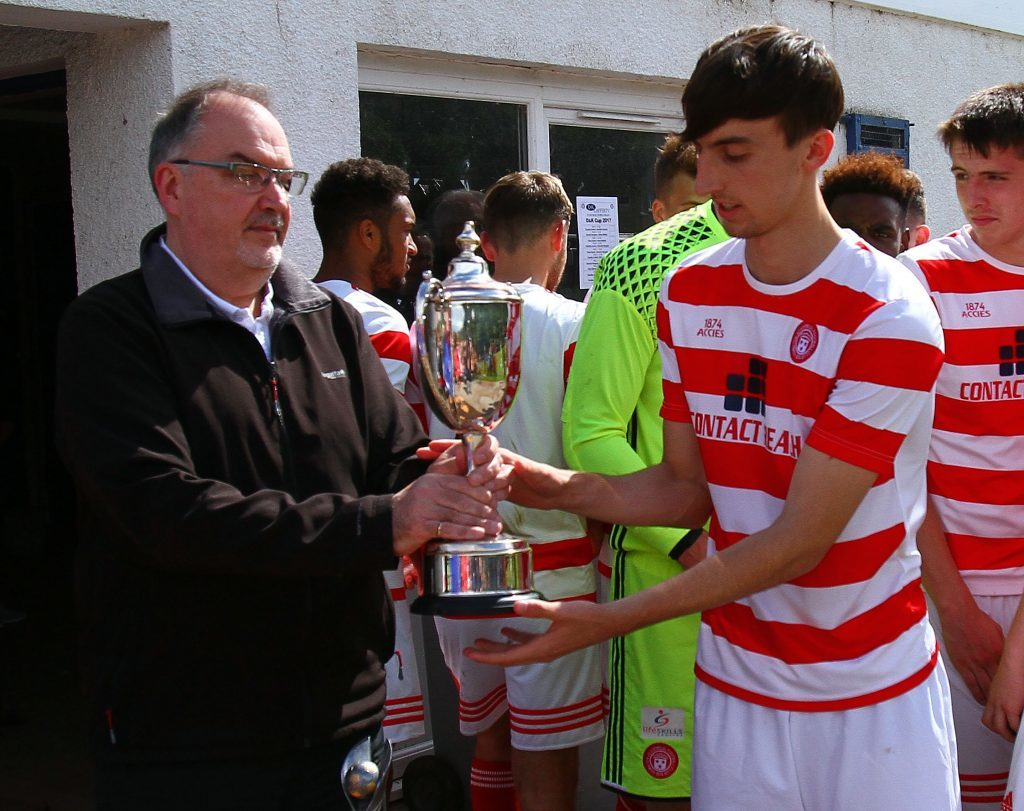 Hamilton Accies captain Marc Kelly receives the D & K Cup from Councillor Jim Lynch.