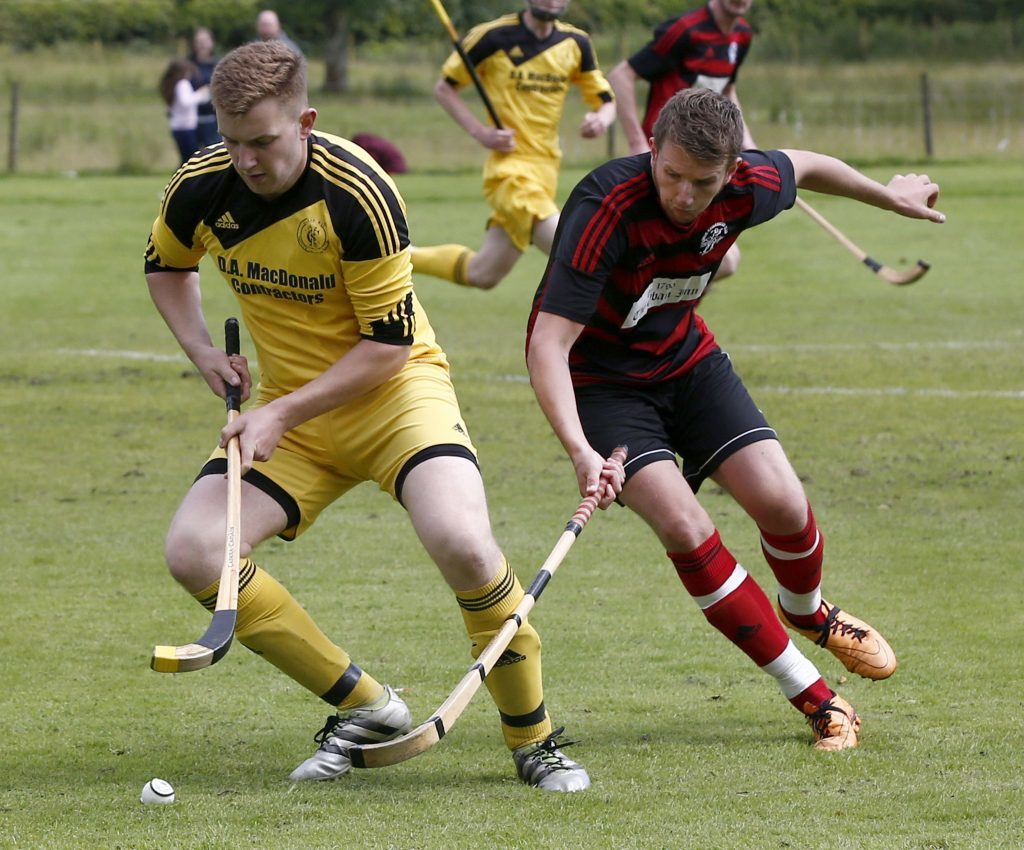 Inveraray's Lewis MacNicol and Gary McKerracher of Oban Camanachd in a tussle for the ball during last weekend's  Camanachd Cup quarter final at the Winterton which the  red and blacks won 5-0. Photograph: Stephen Lawson.