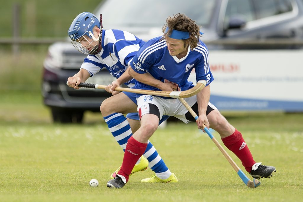 Kyles Athletic's Andrew King shields the ball from Newtonmore's Iain Robinson during the Camanachd Cup tie at the Eilan last weekend. The home side won 4-1. Photograph: Neil Paterson.
