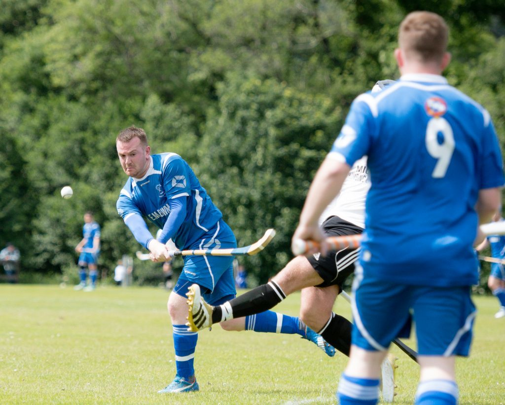 Kilmallie's Martin Stewart has an attempt on goal during the Camanachd Cup quarter final against Lovat.  Photograph: Abrightside Photography.