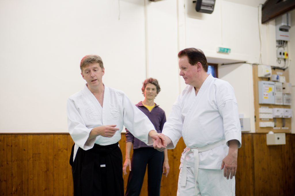 Sensei James Knight demonstrates a technique with student Alex Farquhar