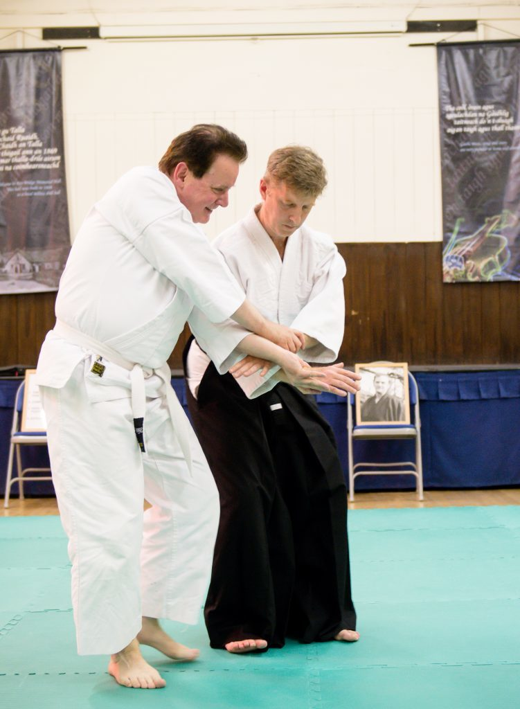 Sensei James Knight works with student Alex Farquhar