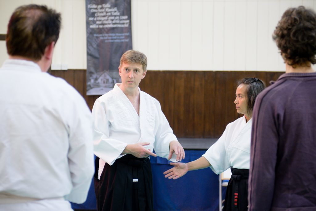Sensei James Knight explains a principle to students with help from his wife, Mai, also an experienced practitioner of this most graceful of martial arts