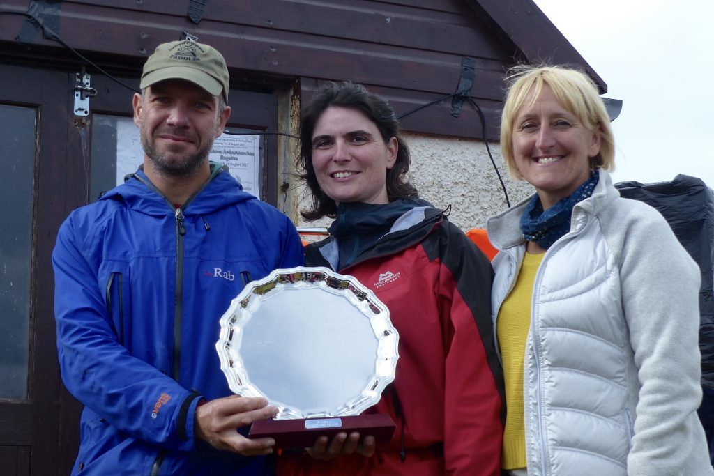 Colin Skeath and his wife, Katriona, centre. are presented with the Carraig Plate by Elaine Shaw