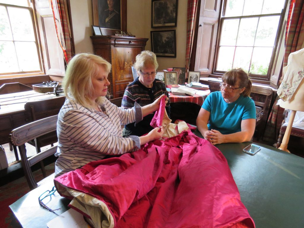 Curatorial volunteers researching and cataloguing the textile collection.