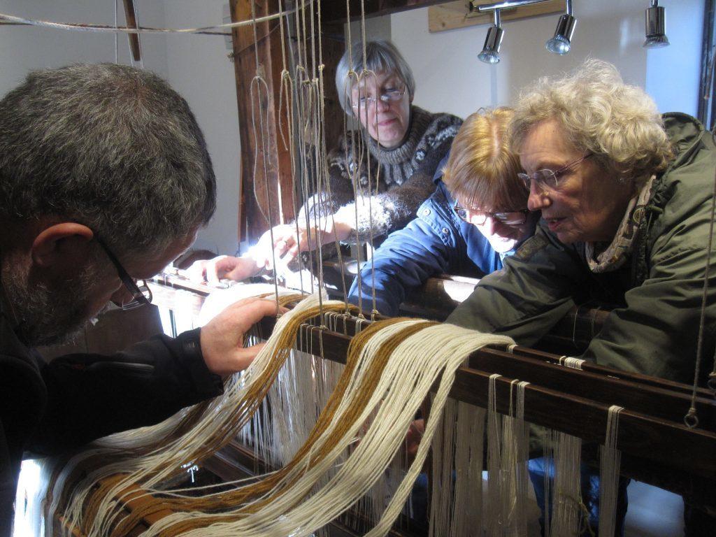 Volunteer weavers warping up Hope MacDougall's 19th century loom.