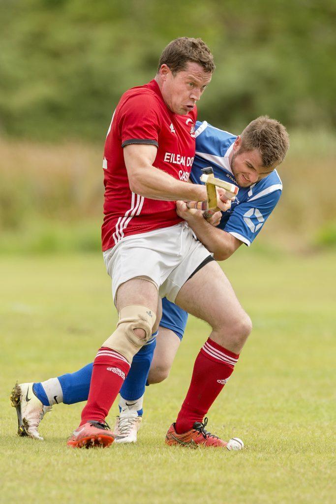 Scott MacLean (Kinlochshiel) and Andrew MacAlister (Kilmallie).  Kinlochshiel v Kilmallie in the Marine Harvest Premiership, played at Kirkton.