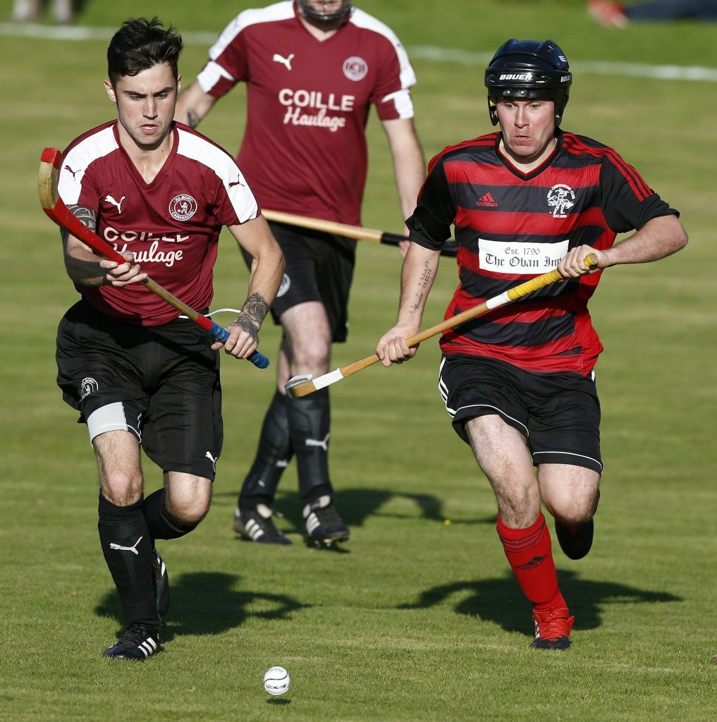 Lochside's Craig MacDougall and Kilmory's Iain Robertson in a race for the ball during the South Division One match on Wednesday August 9. Lochside were convincing 6-0 winners.  Photograph: Stephen Lawson.