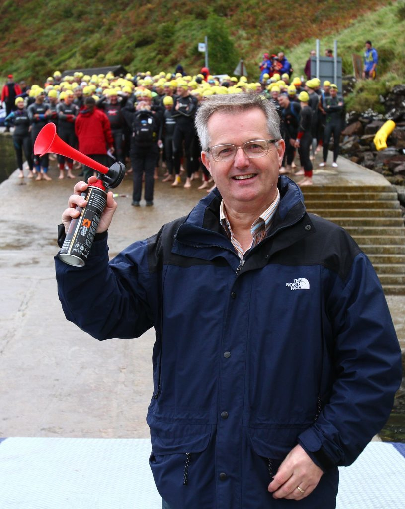 Brendan O'Hara, MP for Argyll and Bute, ready to start the triathlon with the air horn.