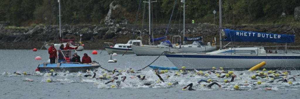 Swimmers set off for Kerrera for the first pat of the triathlon