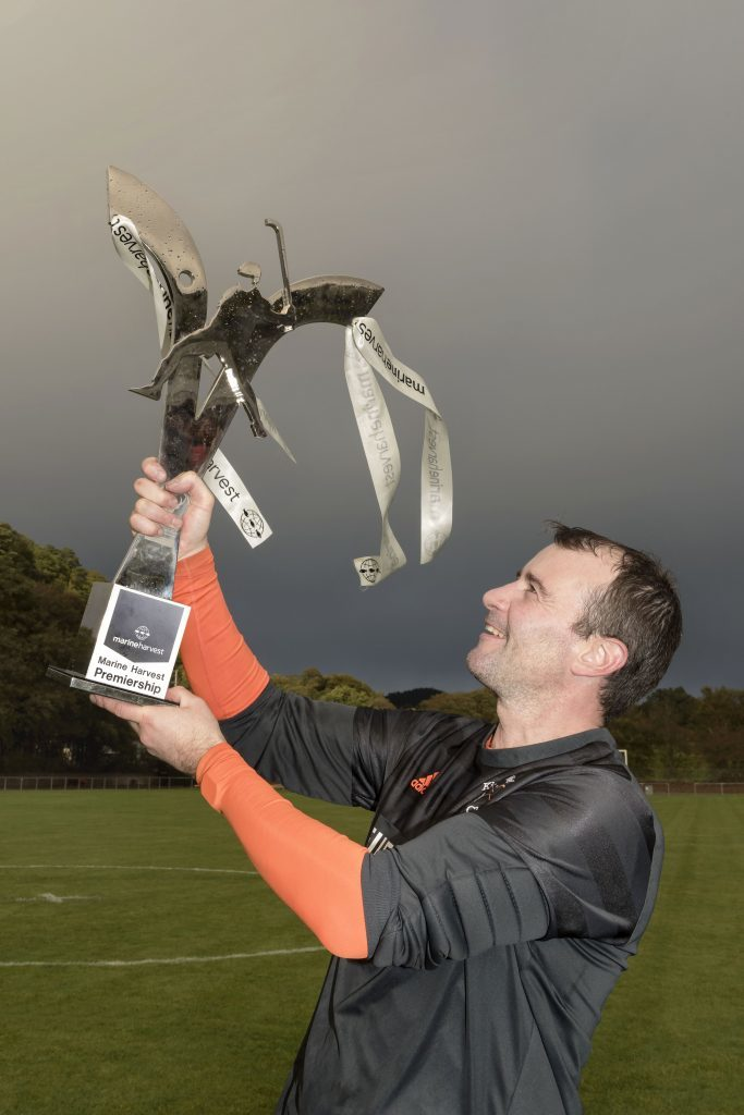 Kinlochshiel captain Scott Kennedy with the Marine Harvest Premiership Trophy. Photograph: Neil Paterson.