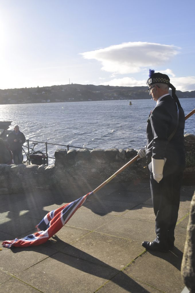 The flag is lowered as the two minutes silence commences. 17_T46_RemembranceSunday05