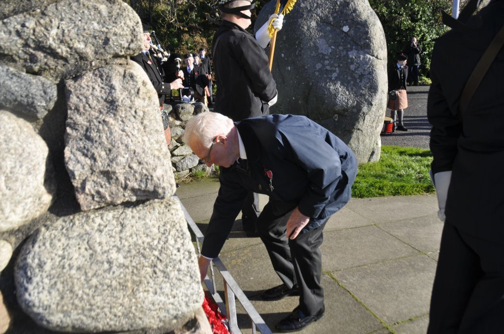 Graham MacQueen lays a wreath in honour of those who have fallen. 17_T46_RemembranceSunday06.