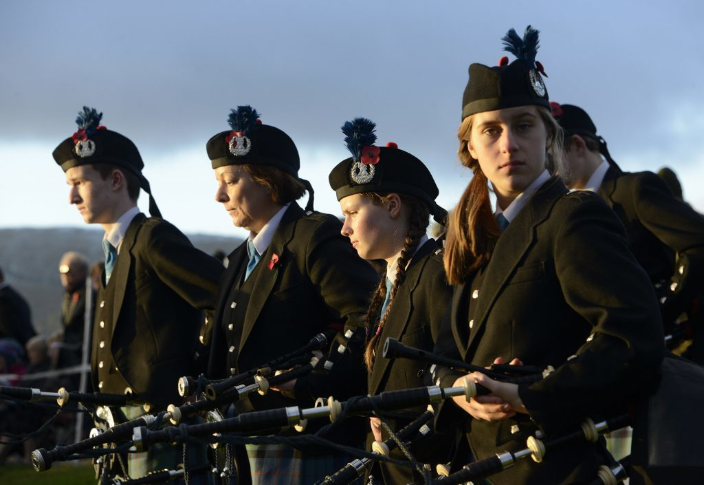 Members of Lochaber Schools Pipe Band watch the service. IF F46 Remembrance Spean 10. Photo: Iain Ferguson, the Write Image.