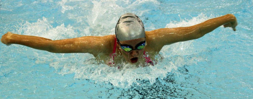 Senior girls champion Ella MacKechnie powers home in the butterfly. She won five golds at the gala.