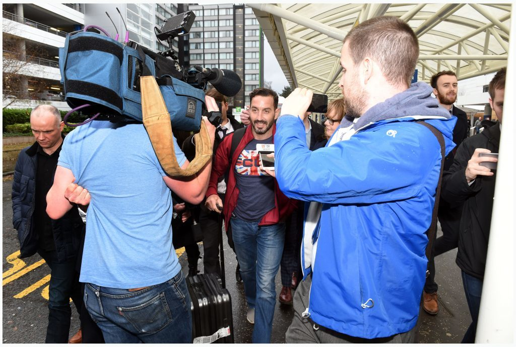 Billy Irving is surrounded by journalists. Picture: Daily Record
