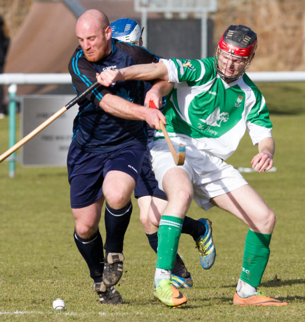 Skye's Kenny Campbell and Beauly's Robbie MacDonald fight for the ball. Photograph: Donald Cameron.