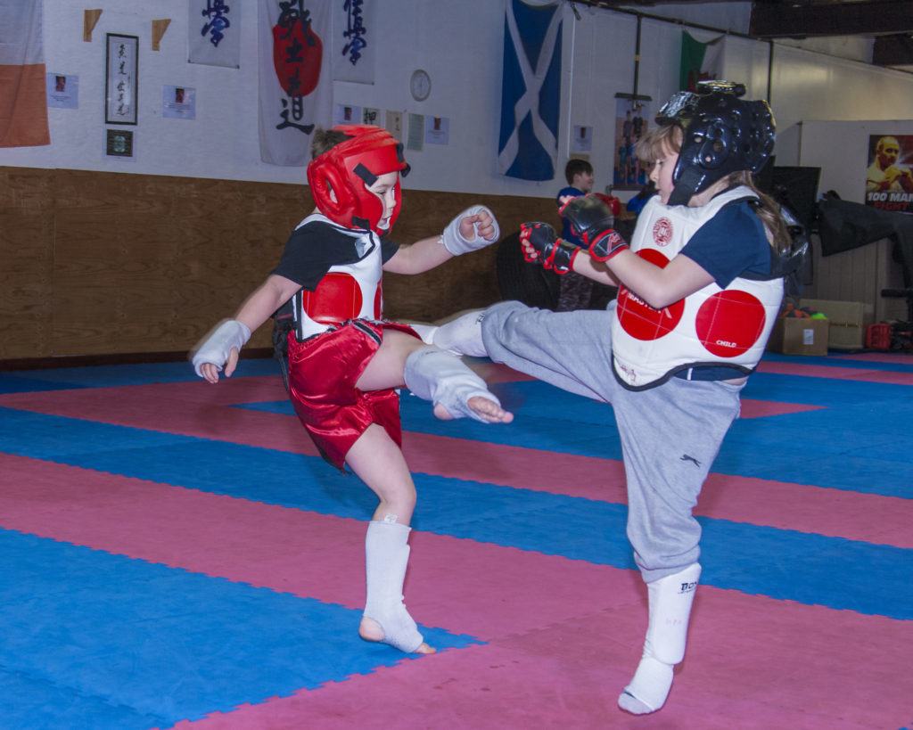 Henley McCulloch and Gracie Hill preparing for the Kyokushin Karate tournament on April 7.