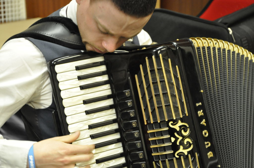 Accordionist Aidn Graham in deep concentration before going on stage at St John's Cathedral 16_T19_HIMF10_Aidangraham