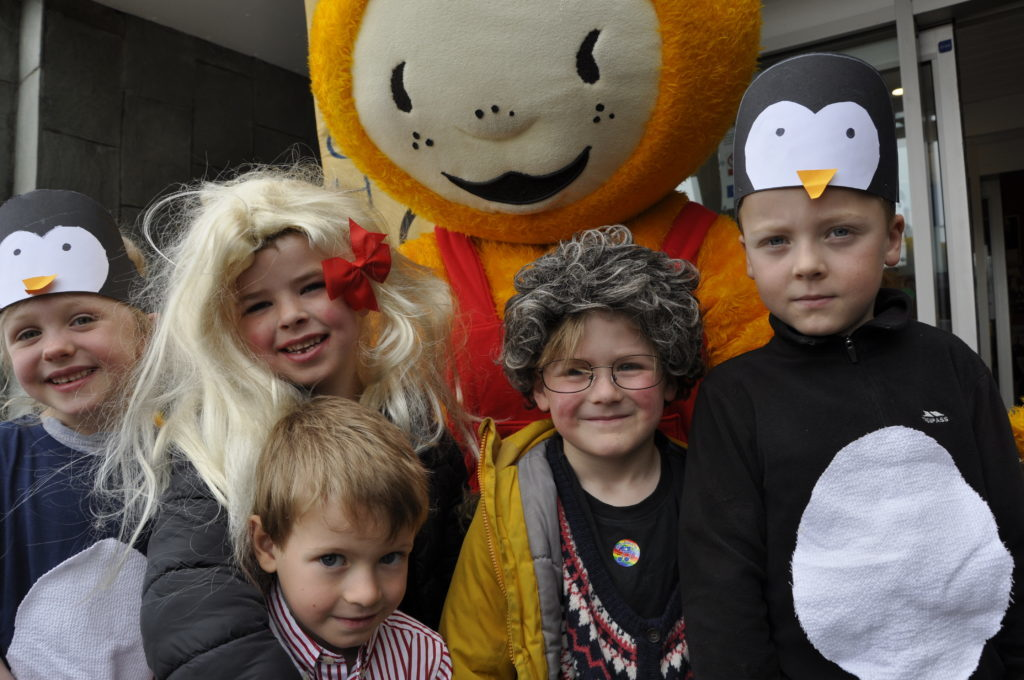 Bookbug mascot and friends pose for a picture after singing at the Corran Halls on Thursday 16_T19_HIMF12_Bookbugandpals