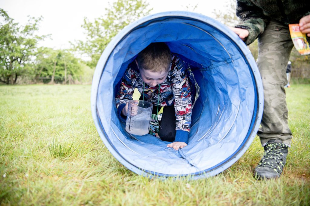 JP F20 Banavie summer fete- Young lad makes his way around the obstacle course_