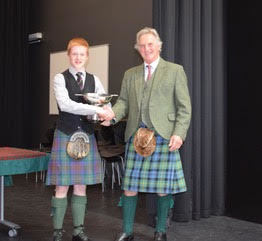 Ross Conner from Campbeltown was winner of the Allan MacInnes trophy, overall trophy for the 15 to under 18 years. Presented by Jamie Mellor, Trustee of the Argyllshire Gathering Piping Trust. The Trust is a major supporter of piping in Argyll NO_T19_HIMF31_RossConnor
