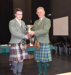 Bobby Allen from Glasgow was winner of the Billy Kirkham trophy, overall trophy for the under 15 age group. Trophy presented by Jamie Mellor, Trustee of the Argyllshire Gathering Piping Trust NO_T19_HIMF33_BobbyAllen