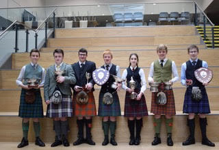 The Saturday afternoon Piping Awards at Oban High School were presented by Jamie Mellor, Trustee of the Argyllshire Gathering Piping Trust NO_T19_HIMF35_aftpipingwinners