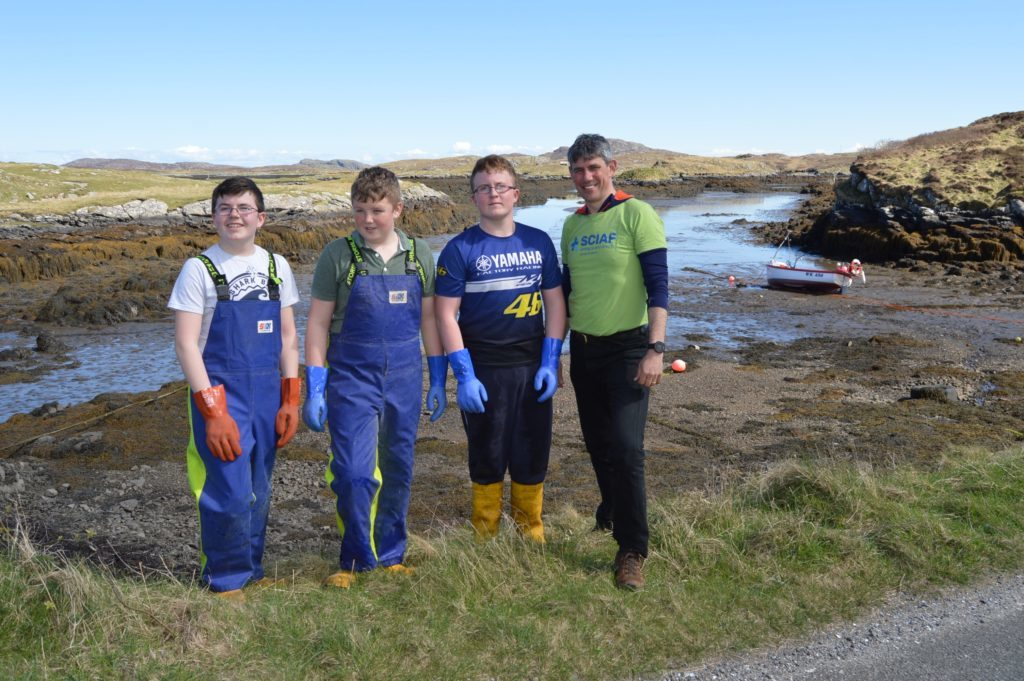 Alistair Dutton with teenage helpers Andrew MacNeil,13, James MacNeil and Cailean MacNeil, 14.